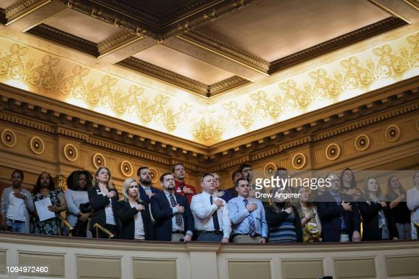 People in the gallery stand for the Pledge of Allegiance at the Virginia State Capitol February 7 2019 in Richmond Virginia Virginia state politics...