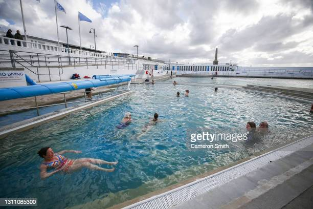 People in the heated pool on April 06, 2021 in Penzance, England. Jubilee Pool is a community run pool housed in a Grade 2 listed art-deco building....