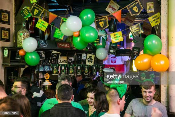 People in the Irish Pub Miodowa seen during Saint Patricks Day celebration on March 17, 2017 in Warsaw, Poland. Saint Patricks Day is a cultural...
