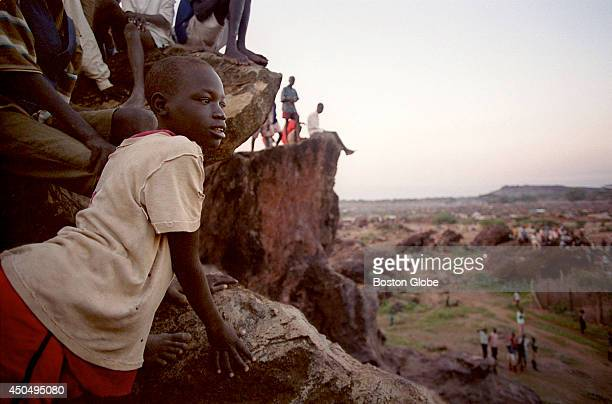 People in the Kakuma refugee camp in Kenya watch the biweekly distribution of food rations just after sunrise When they left the camp for America...