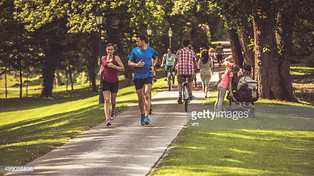 people in the park - public park stock photos and pictures