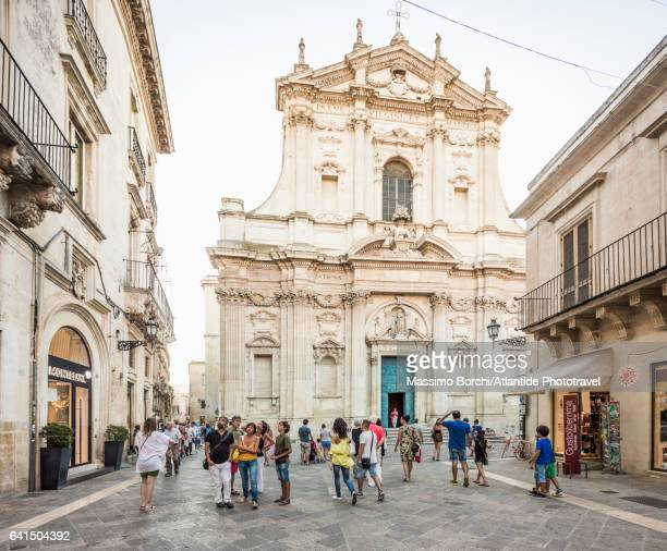 people in the pedestrian area near the chiesa (church) di sant'irene - lecce stock photos and pictures