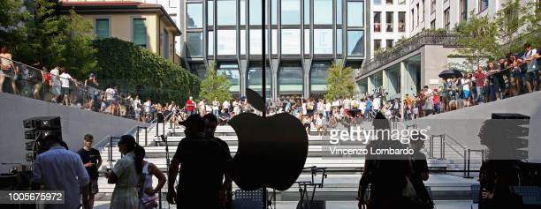 People in the queue to enter the Apple store opening in Milan at Piazza Liberty on July 26 2018 in Milan Italy