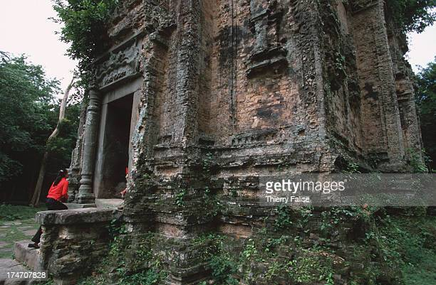 People in the ruins of Sambor Prey Kuk which was the 7th century capital of the Chenla Kingdom in preAngkor civilization