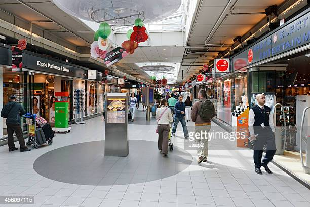 People in the Shopping mall at Schiphol Airport near Amsterdam