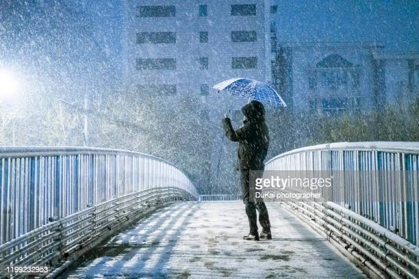 people in the snow - beijing stock pictures, royalty-free photos & images