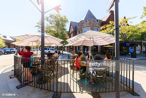 people in the street cafe in scarsdale, westchester county. - westchester county stock pictures, royalty-free photos & images