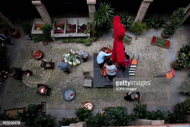 People in the terrace of 'Corrala de Santiago' preparing the altar with the cross for the upcoming 'Dia de la Cruz' El día de la Cruz or Día de las...