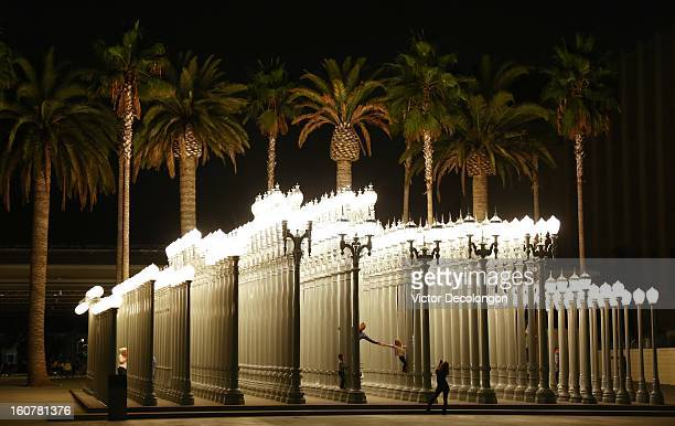 People in the 'Urban Light' sculpture by Chris Burden at LACMA on October 20 2012 in Los Angeles California