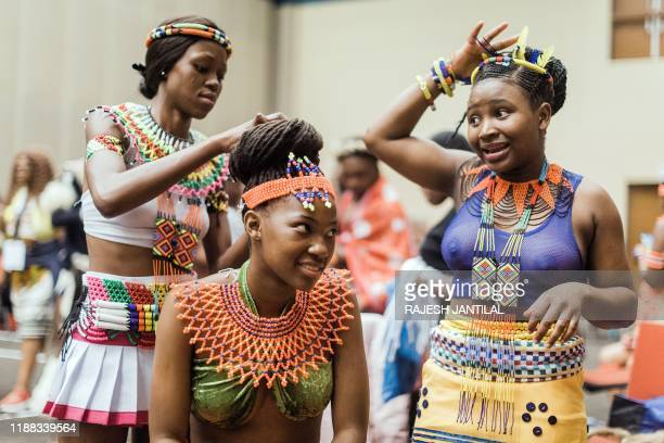 People in their traditional Zulu outfits prepare to take part in the 3 day Indoni Cultural Festival on December 13 in Durban. - The Indoni festival,...