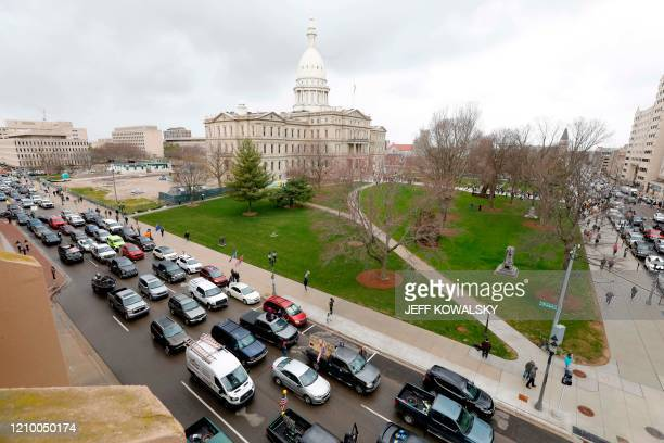 People in their vehicles protest against excessive quarantine orders from Michigan Governor Gretchen Whitmer around the Michigan State Capitol in...