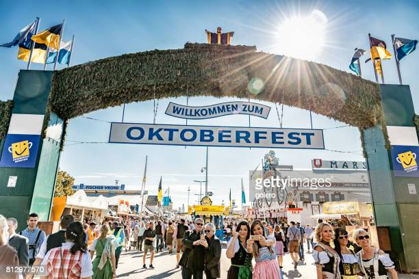 people in traditional clothe at oktoberfest in munich