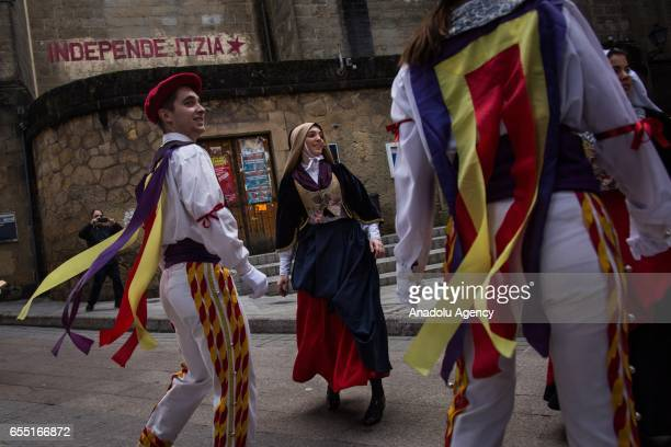 People in traditional clothes dance during a citizen consultation voting in Gipuzkoa Basque Spain on March 19 2017 People are asked if they want...