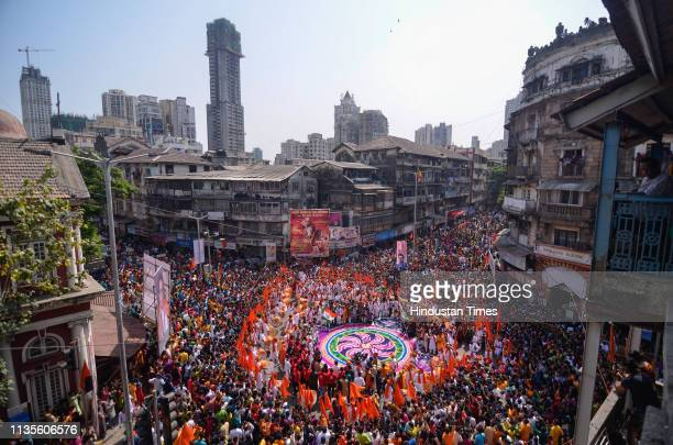 People in traditional clothes take part in the procession to celebrate the Marathi New Year 'Gudi Padwa' at Girgaon on April 6 2019 in Mumbai India...