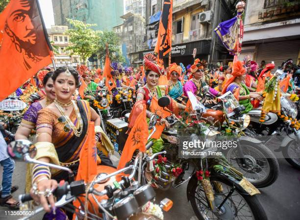 People in traditional clothes take part in the procession to celebrate the Marathi New Year, 'Gudi Padwa', at Girgaon, on April 6, 2019 in Mumbai,...