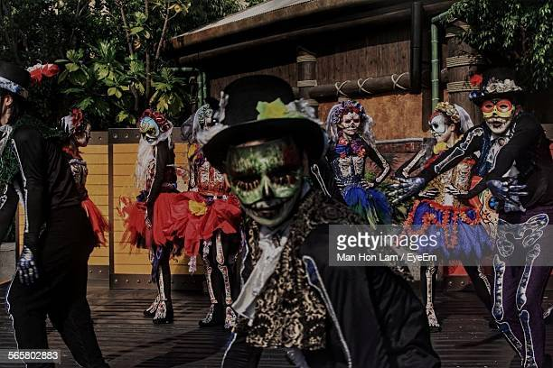 People In Traditional Costume Celebrating Day Of The Dead Festival