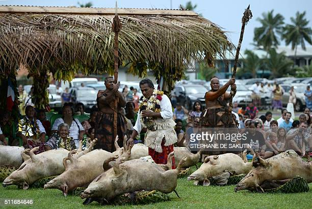 People in traditional costumes give a ceremony by 'la grande chefferie du royaume d'Uvea' in Wallis island on February 22 in honor of French...