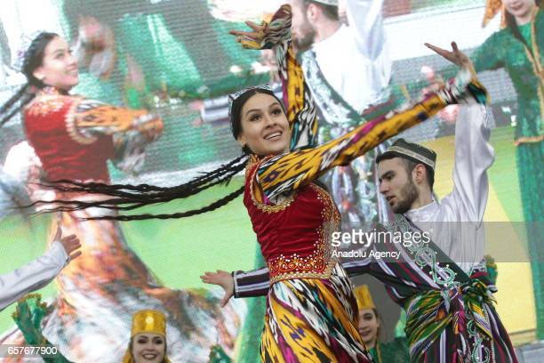People in traditional costumes participate in Nowruz celebrations in Kazan Russia on March 25 2017 International Nowruz Day which marks the first day...
