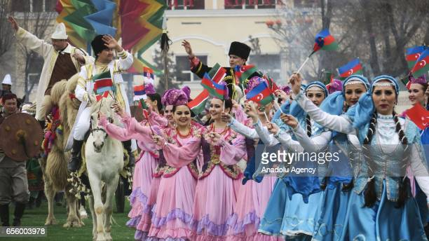 People in traditional costumes participate Nowruz celebrations in Astana Kazakhstan on March 21 2017 International Nowruz Day which marks the first...