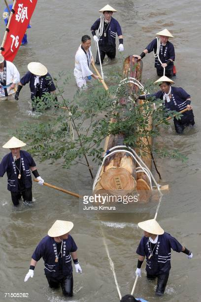 People in traditional dress pull wood along the Isuzu River to the Inner Shrine of Japan's biggest shrine ?Ise Jingu? during the 62nd Okihiki-Gyoji...