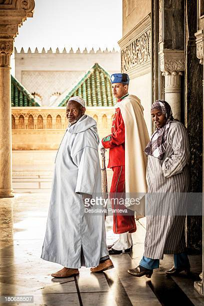 People in traditional Moroccan dresses entering the Mausoleum of Mohammed V in Rabat
