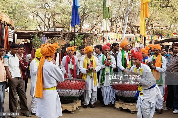People in traditional Rajasthani dress dancing at Surajkund Mela Faridabad Haryana India