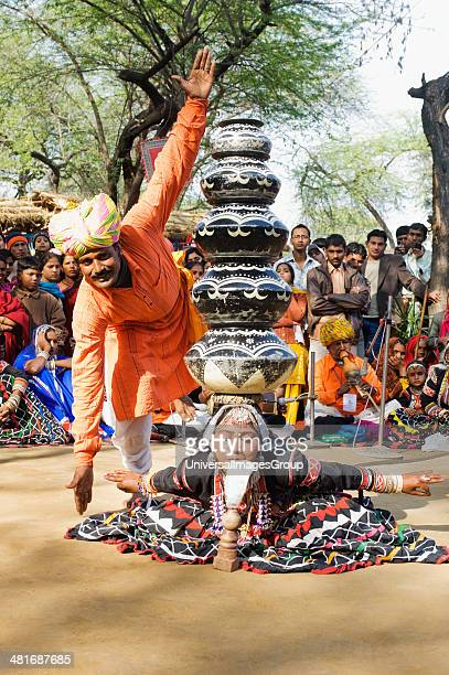People in traditional Rajasthani dress performing kalbelia dance in Surajkund Mela Faridabad Haryana India