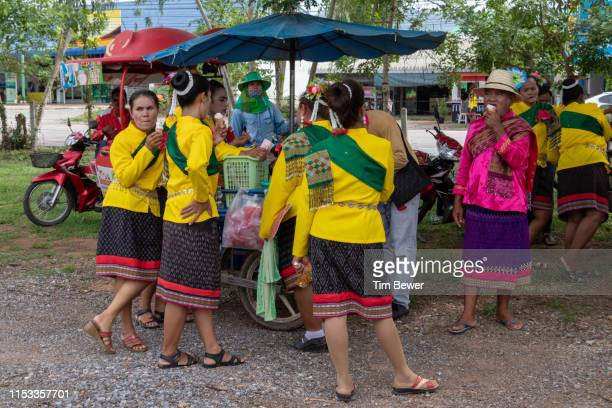 people in traditional thai clothes eating ice cream. - tim bewer stockfoto's en -beelden