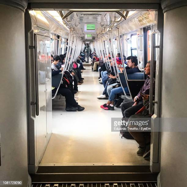 people in train - train interior stock photos and pictures
