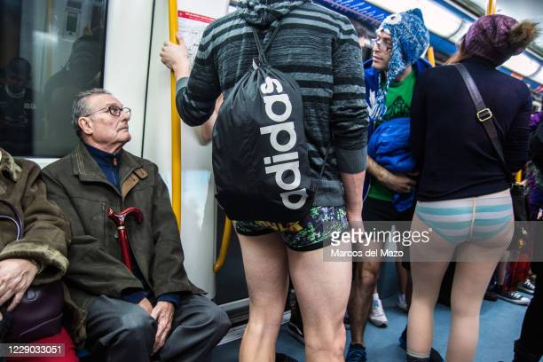 "People in underwear inside the metro during the annual ""No Pants Subway Ride""."