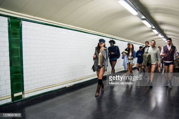 "People in underwear walking inside the metro during the annual ""No Pants Subway Ride""."