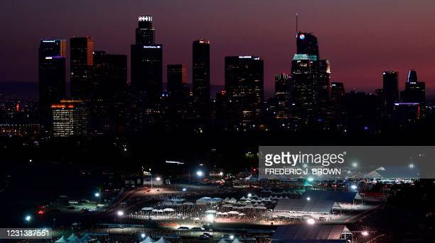 People in vehicles arrive at the Dodger Stadium parking lot for their Covid-19 vaccinations in Los Angeles, California on February 25, 2021.