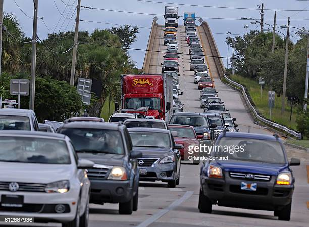People in vehicles make an evacuation route on Wednesday Oct 5 2016 over a Florida State Road 520 bridge heading west from Merritt Island Fla...