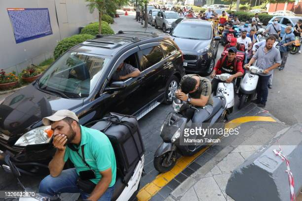 People in vehicles queue to refuel from a petrol station on July 02, 2021 in Beirut, Lebanon. Lebanon is going through the world's worst economic...