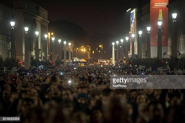 People in Via della Conciliazione during the show Fiat Lux : Illuminating Our Common Home, on December 8, 2015 at the Vatican. Images by some of the...