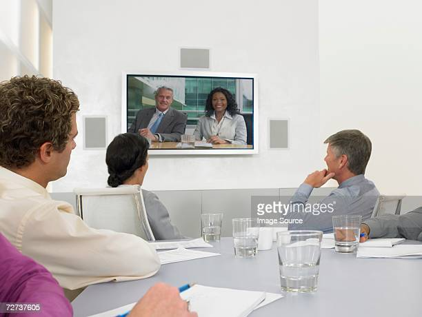 People in video conference meeting
