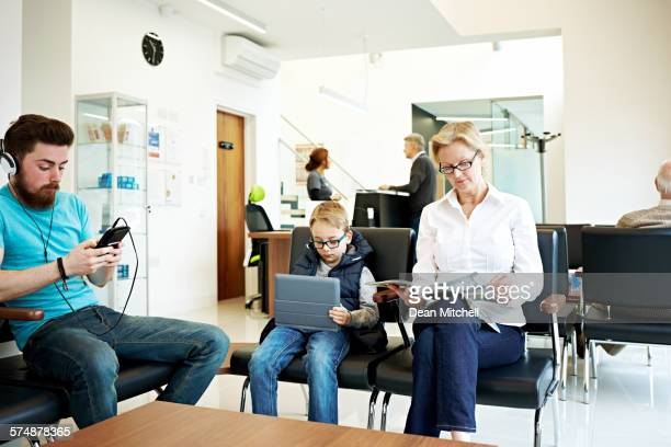 people in waiting room of a dental clinic - music halls stock pictures, royalty-free photos & images