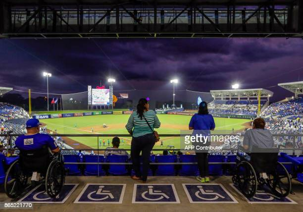 People in wheelchairs wait the begining of the friendly game of National Baseball Team of Nicaragua against the National Baseball Team of Taiwan in...
