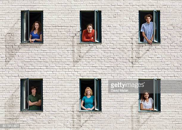 people in windows in a wall - looking at view foto e immagini stock