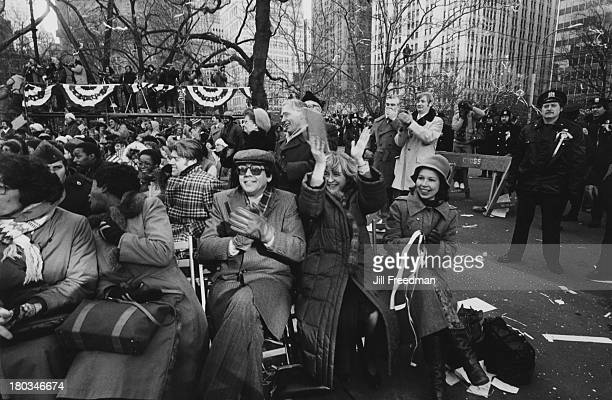 People in winter clothing show their appreciation at a ceremony in City Hall Park New York City 1981