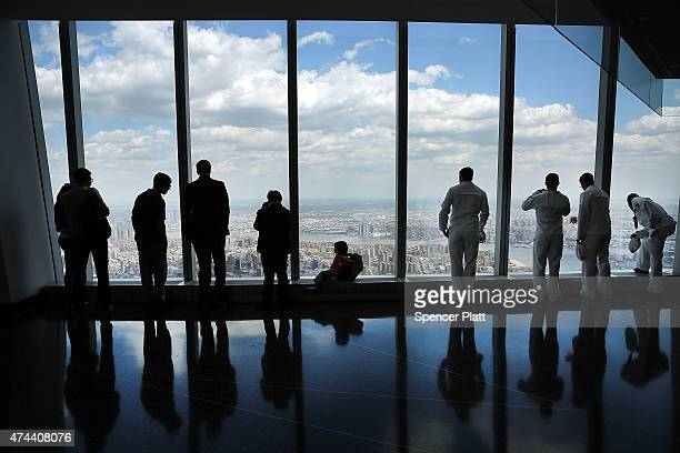People including a group of sailors in New York for Fleet Week look out from the newly built One World Observatory at One World Trade Center on May...