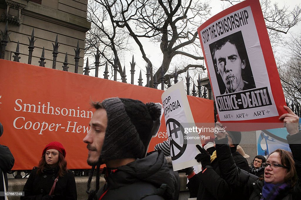 People including artists and free speech activists converge to support the work of the late multi-media artist David Wojnarowicz (pictured) in front of the Smithsonian Institution`s Cooper-Hewitt on December 19, 2010 in New York City. Wojnarowicz`s four-minute video was part of the National Portrait Gallery's 'Hide/Seek' show until it was pulled after the Catholic League and members of Congress complained that the piece was sacrilegious due to a sequence showing ants crawling on a statue of Christ. The banning of the video, which led to its viewing at the New Museum in New York, has outraged artists and political activists who call the action censorship.