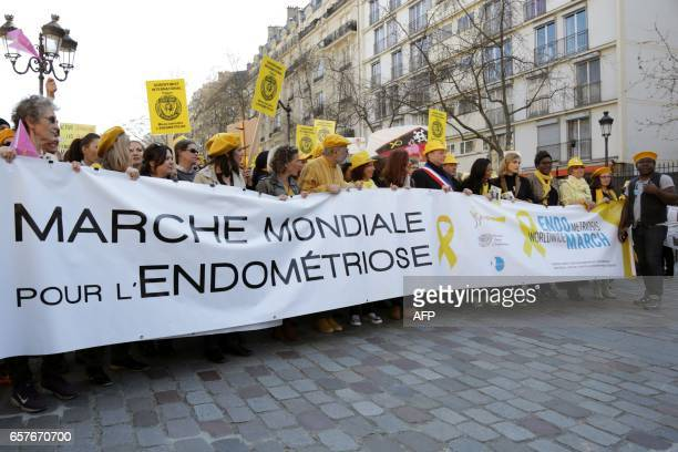People including French MP and mayor of Paris 15th disctrict Philippe Goujon and French actress Julie Gayet take part in a rally organised as part of...