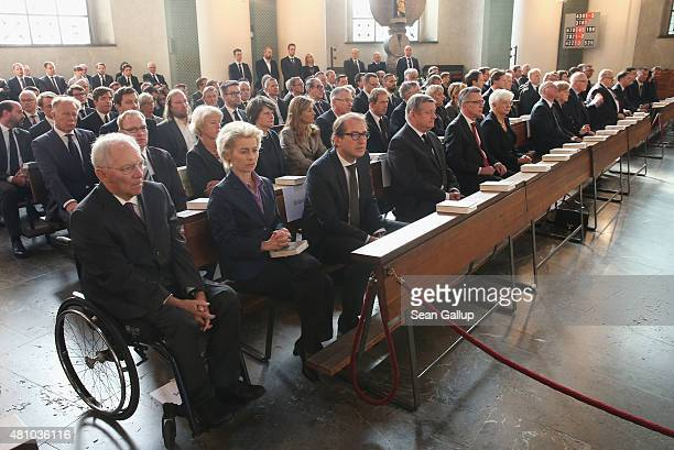 People including German Finance Minister Wolfgang Schaeuble and Defense Minister Ursula von der Leyen attend a memorial service for recentlydeceased...