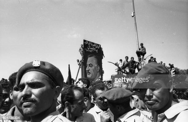 People including military all over the street of Cairo trying to get a last glimpse of president Gamal Abd al-Nasser coffin passing through the...