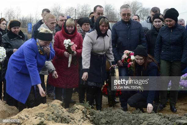 People including relatives grieve at the grave of Irina Medyantseva a victim of April 3 blast in the Saint Petersburg metro, during her funeral at a...