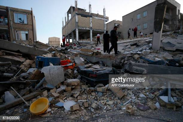 People including rescue personnel conduct search and rescue work following a 73magnitude earthquake at Sarpole Zahab in Iran's Kermanshah province on...