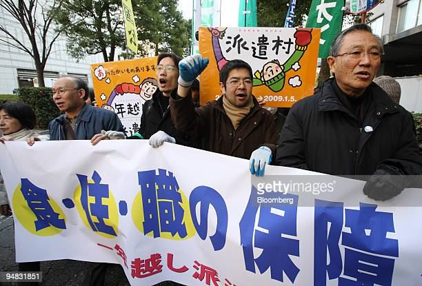 People including temporary workers who lost their jobs and homes head to Japan's national diet during their rally in Tokyo, Japan, on Monday, Jan. 5,...