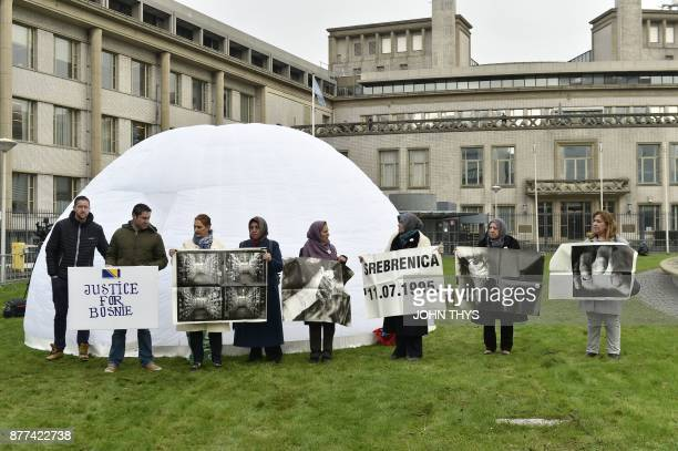 People including victims protest in front of the International Criminal Tribunal for the former Yugoslavia in The Hague on November 22 during the...