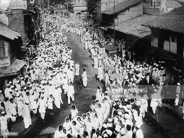 1930 Bombay A long procession through the streets of Bombay composed largely of women carrying banners advocating the boycotting of goods This...